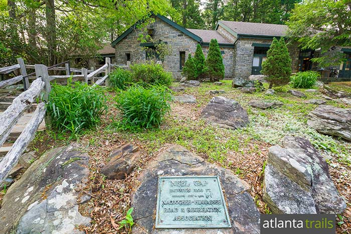 Hike the Appalachian Trail at historic Neels Gap, crossing through a stone breezeway at Mountain Crossings, a well-loved AT outfitter