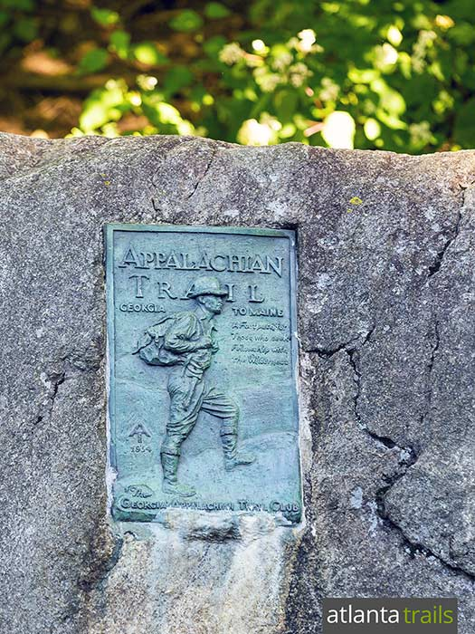 The Appalachian Trail crosses through Unicoi Gap near Helen, Georgia, commemorated by a bronze AT plaque