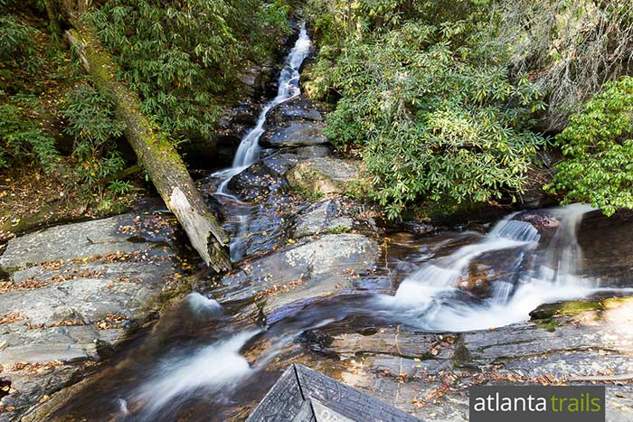 Hike the Dukes Creek Falls Trail to an enormous 150-foot-tall waterfall near Helen, Georgia