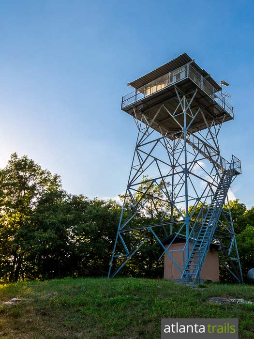 Hike the Grassy Mountain Tower, a historic fire lookout tower in Georgia's Cohutta Wilderness, climbing from the shores of Lake Conasauga
