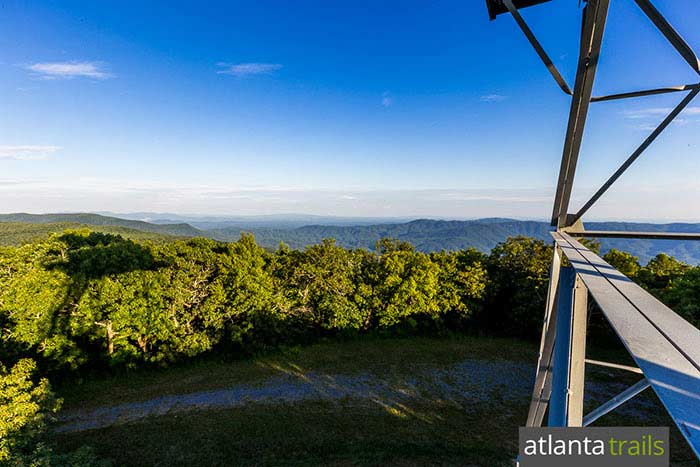 Hike the Grassy Mountain Tower Trail to a historic lookout fire tower in Georgia's Cohutta Wilderness, catching stunning views of nearby Fort Mountain