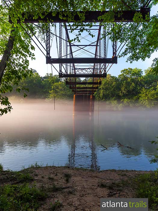 Hike Jones Bridge Park on the Chattahoochee River in metro Atlanta to a historic bridge and stunning early morning fog