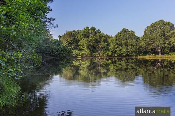 The Jones Bridge Trail visits a glassy lake near the Chattahoochee River