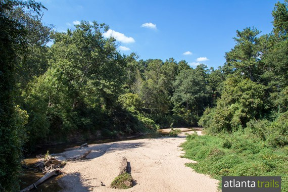 South Fork Peachtree Creek flows shallowly across the so-called Dog Beach, a wide, sandy bank