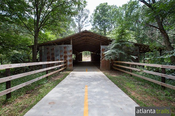 The paved Alexander Lake and Panola Mountain PATH trail travels through a historic barn near Panola Mountain