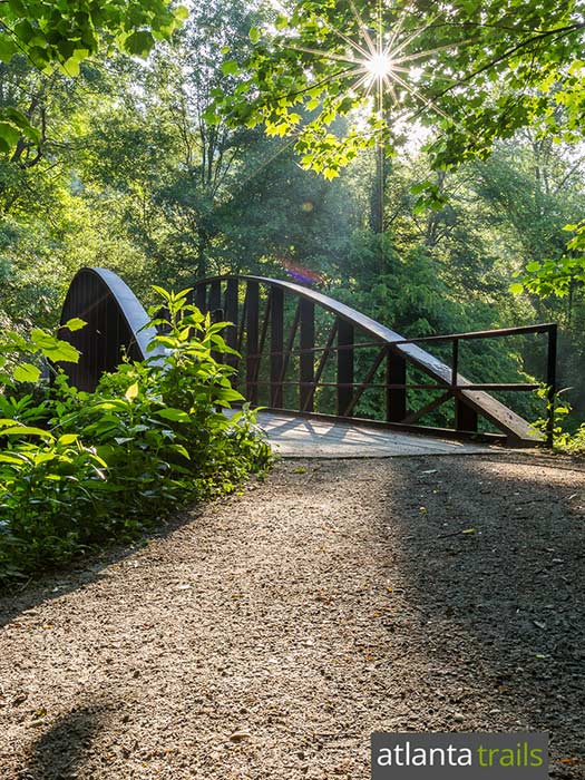 Hike the Powers Island Trail on the Chattahoochee River in metro Atlanta, crossing a footbridge to explore a historic island