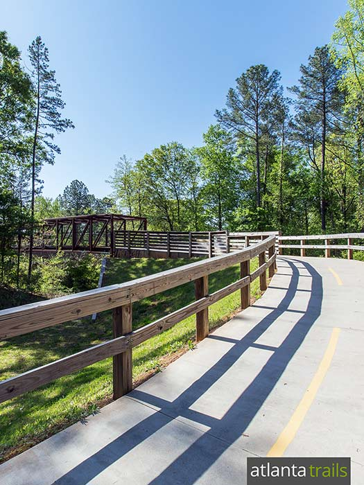 Run the South Peachtree Creek Trail at Mason Mill Park in Decatur, crossing a train trestle bridge and running a boardwalk through treetops