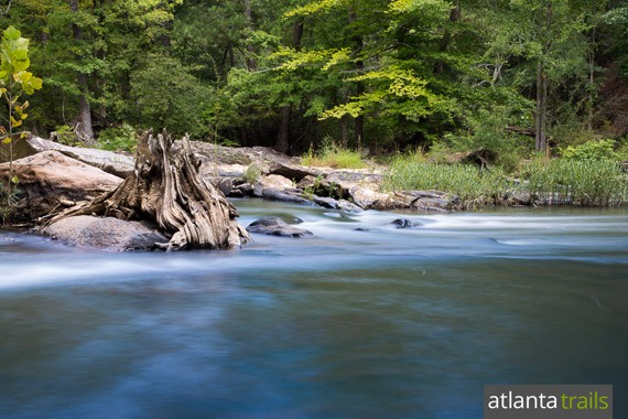 Hike the Sweetwater Red Trail to the sandy, waterfall filled Sweetwater Creek