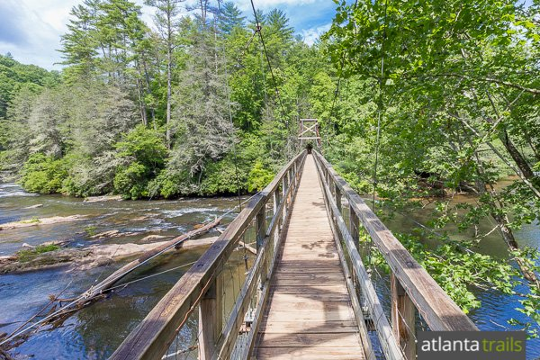 Hike the Benton MacKaye Trail near Blue Ridge to a swinging suspension bridge over the Toccoa River