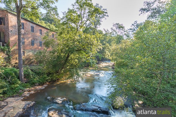 Hike to the covered bridge at Roswell Mill, catching views of historic mill ruins and tumbling whitewater on Vickery Creek
