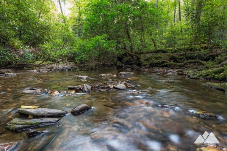 Hike the High Shoals Falls Trail through a beautiful, shady, rhododendron-filled creek valley near Helen, GA