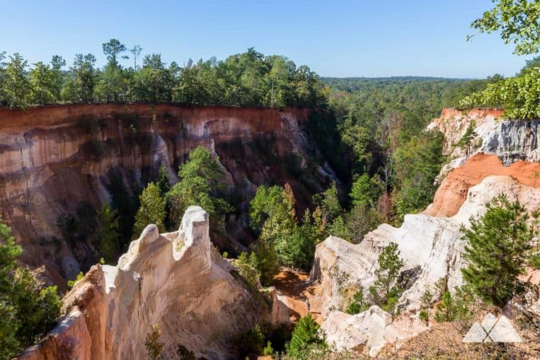 Explore colorful sandstone canyon walls at Providence Canyon State Park: Georgia's best wintertime hikes