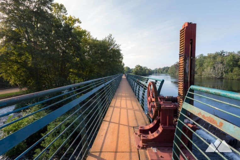 Explore Rae's Creek Aqueduct Park on the Augusta Canal Towpath Trail, visiting a beautiful waterfall and crossing Long Spillway
