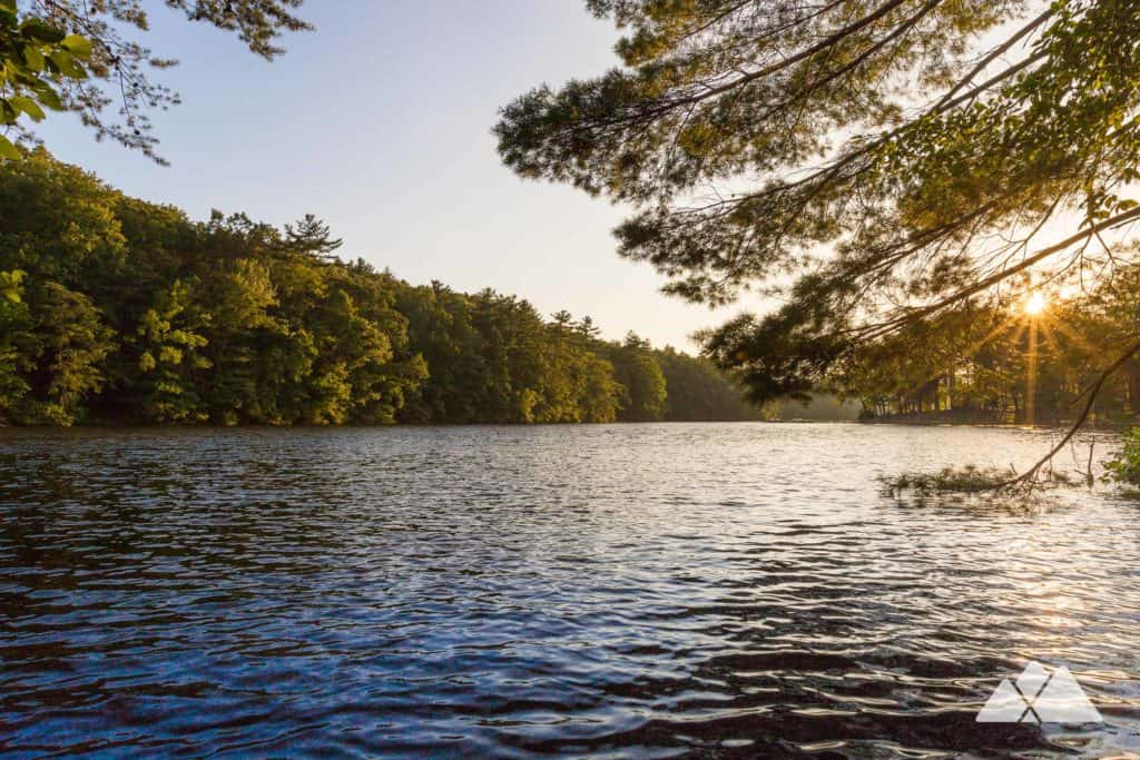 Hike the Lake Trail to scenic views of a mountaintop lake at Fort Mountain State Park in North Georgia