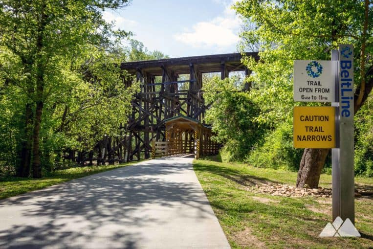 Follow the Northside BeltLine Trail at Tanyard Creek Park in Atlanta under a towering historic train trestle
