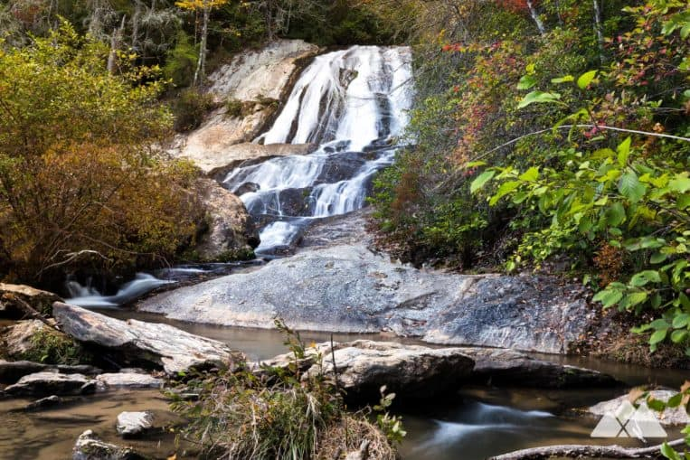 Hike to the stunning Dicks Creek Falls in North Georgia, a gorgeous waterfall that spills into the Chattooga River near Clayton
