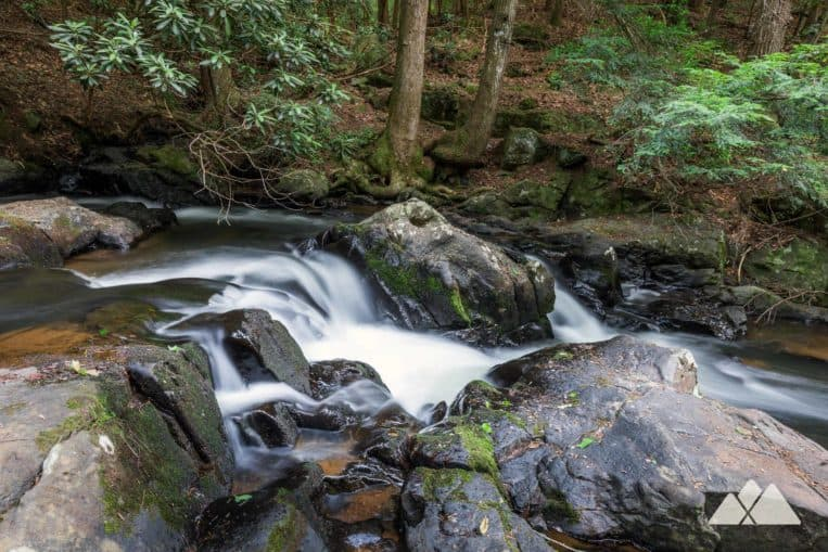 Big Canoe, Georgia: hike the Meditation Park trails through a lush, mossy forest to a covered bridge, rushing waterfalls and a historic cabin