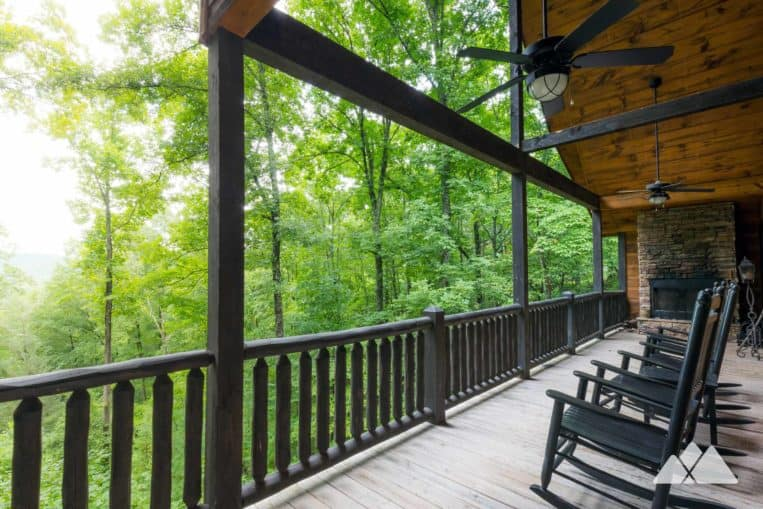 Blue Ridge cabin review: Hawks Ridge from Southern Comfort Cabin Rentals features an oversized covered porch with an outdoor fireplaces and a beautiful view