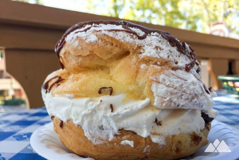 Top places to eat in Helen, Georgia: enjoy an enormous, fluffy, and ultra-delicious chocolate-drizzled cream puff at Hofer's Bakery