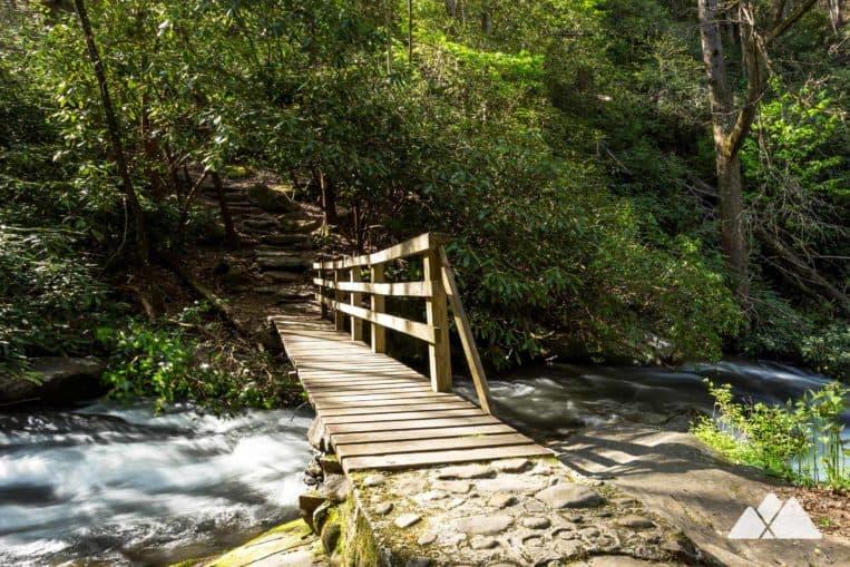 Hemlock Falls Trail: hike across a rustic bridge over Moccasin Creek on the way toone of Georgia's most beautiful waterfalls