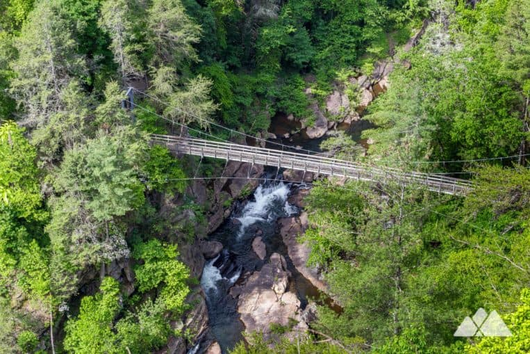 Hike the Sliding Rock Trail to a towering suspension bridge, swimming hole and rock slide in Tallulah Gorge State Park