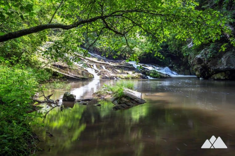 Carters Lake top hikes: cross a suspension bridge to visit two tumbling waterfalls on the Tumbling Waters Nature Trail